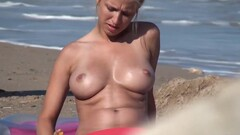 Those tits are simply perfect - blond hottie on the beach Thumb