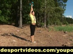 Sporty girl does outdoor naked exercises Thumb