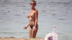 Hot body brunette with perfect tits filmed on topless beach Thumb