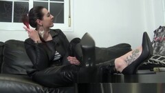 Femdom Mistress In Full Leather Outfit Puts On Long Gloves Thumb