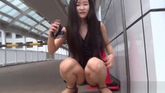 Fetish asian whore peeing in gutter Thumb