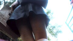 Upskirt in the stairs of aleather skirt Thumb