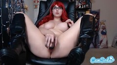 Solo babe in boots and specs toys with herself Thumb