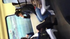 Girl in black tights and flats on train Thumb