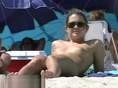 Appealing chicks caught on a hidden nudist beach Thumb