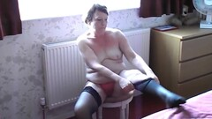 Exhibitionist MILF Getting Dressed in Front of the Window Thumb