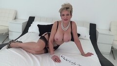 British mature Lady Sonia playing with her big boobs Thumb