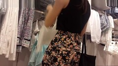 Beautiful Young Woman In Mini Skirt Caught In The Clothes Store Thumb